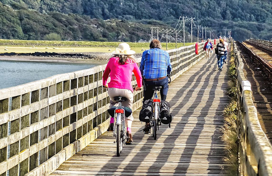 Two cyclists on a bridge