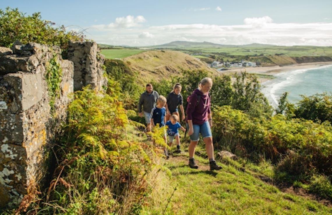 Family walking along the coast