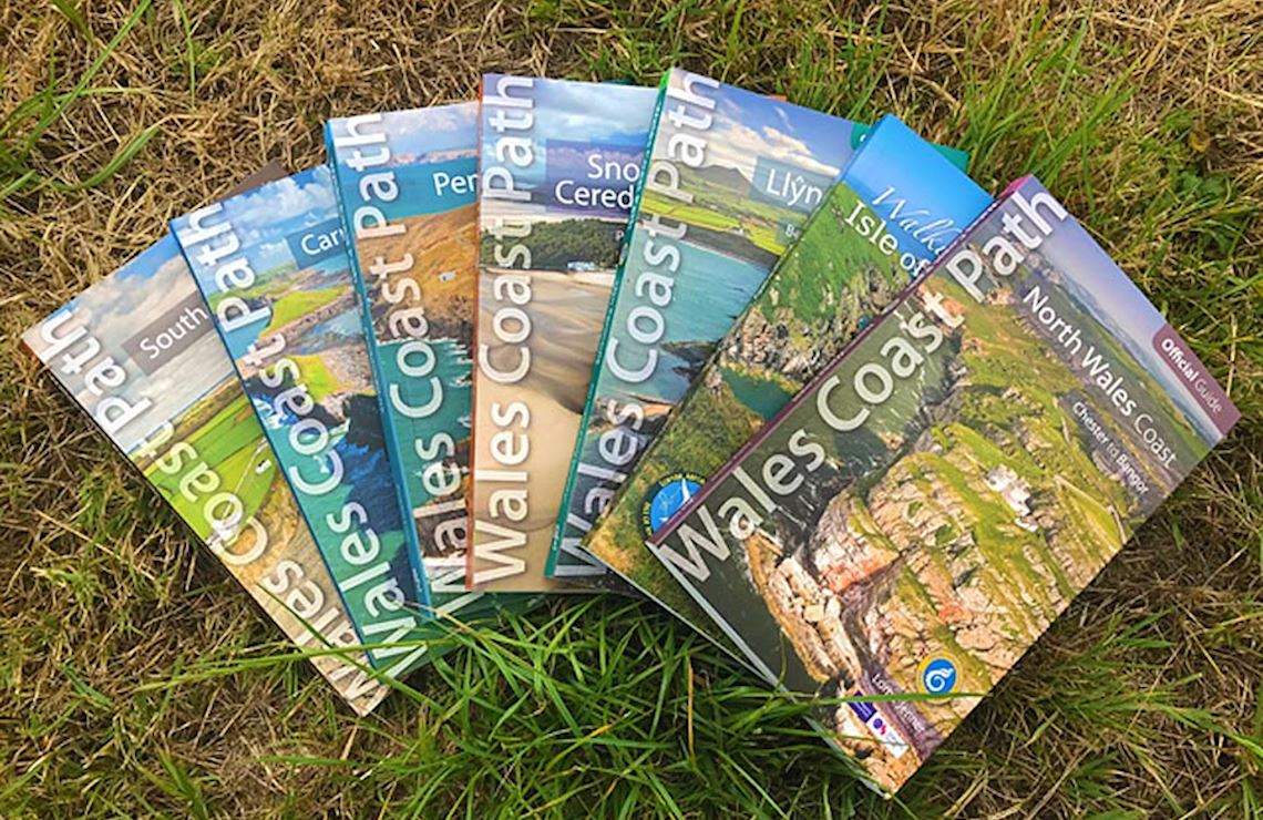 Official Wales Coast Path guidebooks together